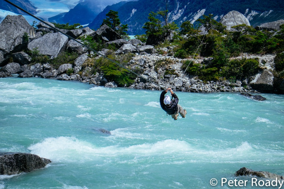 Tyrolean traversing over a river in Patagonia